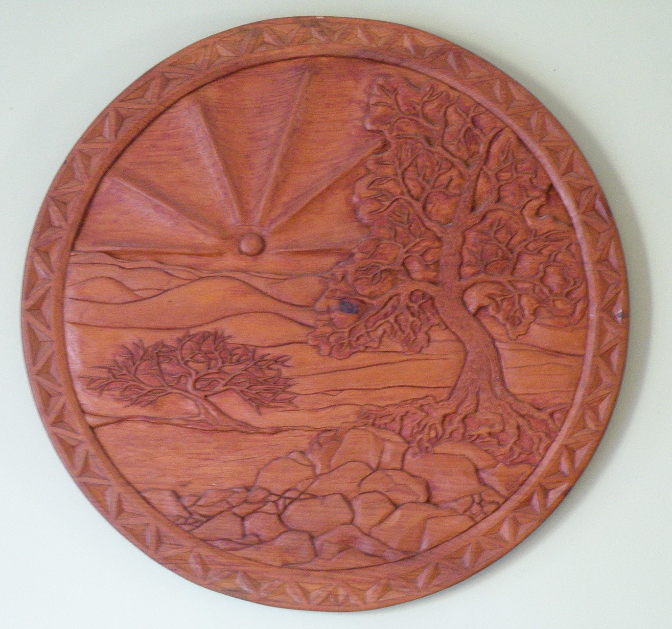 [Wood carving pine slab, about 27 inches in diameter]